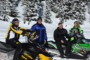 A group of snowmobilers smiling