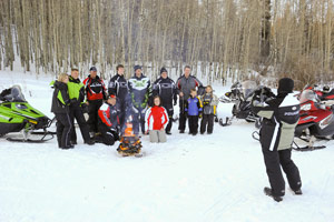 Group of snowmobilers having their photo taken