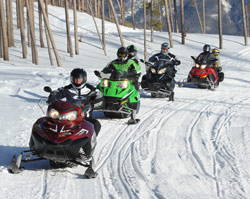 Snowmobiling along a groomed path