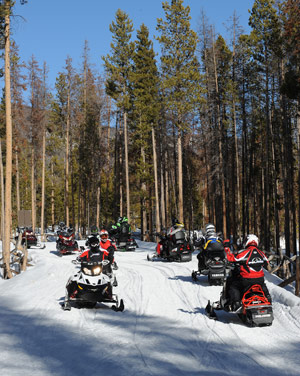 Snowmobiling along groomed trails
